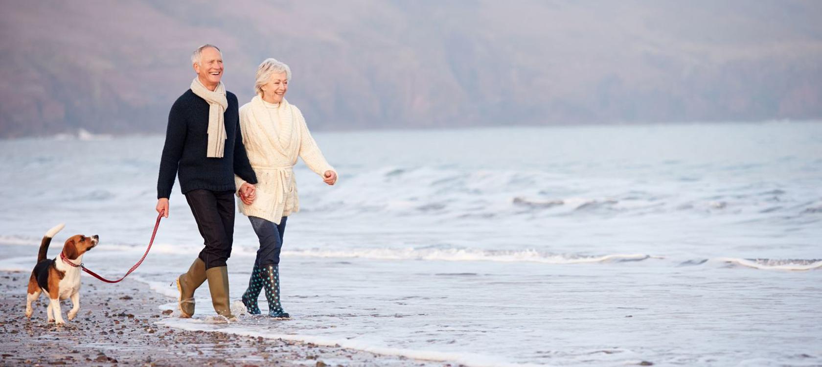 Senior-Couple-Walking-Dog